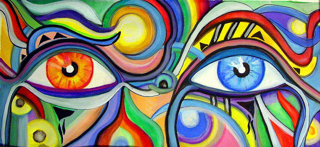 Abstract painting of two differently colored eyes against a background of different colors and patterns
