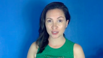 Photo of Dr. Morghan Velez wearing a green shirt, speaking in front of a blue background